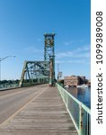 Small photo of Portsmouth, New Hampshire, USA - August 9, 2009: Original World War I Memorial Bridge over Piscataqua River between Portsmouth, New Hampshire and Kittery, Maine before center span replaced in 2012.