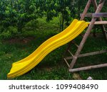 playground slide yellow color... | Shutterstock . vector #1099408490