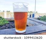 fresh draft beer near the beach | Shutterstock . vector #1099413620