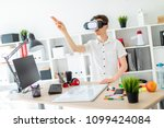 a young man in virtual reality... | Shutterstock . vector #1099424084