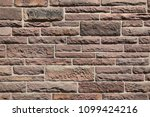 wall of red sandstone | Shutterstock . vector #1099424216