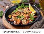prawns shrimps roasted in... | Shutterstock . vector #1099443170