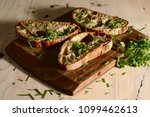 freshly baked bread on wooden... | Shutterstock . vector #1099462613