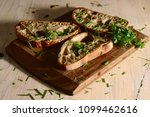 freshly baked bread on wooden... | Shutterstock . vector #1099462616