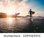 silhouette of happy surfers... | Shutterstock . vector #1099469543