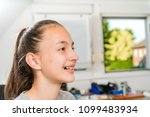 teenager with braces on her... | Shutterstock . vector #1099483934