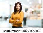 young pretty woman crossing his ... | Shutterstock . vector #1099486883