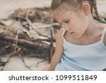 portrait of one sad little girl.... | Shutterstock . vector #1099511849