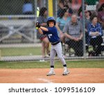Young Boy Batting During A...