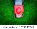 top view on mowing the grass.... | Shutterstock . vector #1099517066