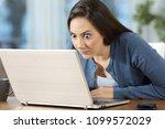 perplexed woman reading online... | Shutterstock . vector #1099572029