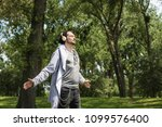 carefree man with arms... | Shutterstock . vector #1099576400