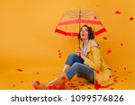white girl with umbrella posing ... | Shutterstock . vector #1099576826