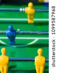 Small photo of Perspective view on the team of a soccer table game