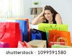 worried shopaholic woman after... | Shutterstock . vector #1099591580