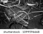 antique bicycle sits amongst... | Shutterstock . vector #1099596668