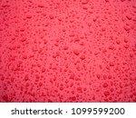 raindrops on red metal texture... | Shutterstock . vector #1099599200