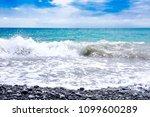 Sea  Blue Sky  Waves And Pebbl...