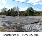 railroad crosses a street in... | Shutterstock . vector #1099627406