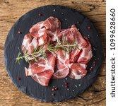 coppa di parma ham on slate... | Shutterstock . vector #1099628660