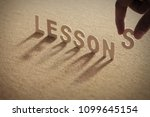 lessons wood word on compressed ... | Shutterstock . vector #1099645154