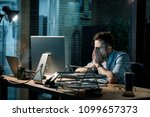 Small photo of Fatigue man in shirt rubbing face while watching computer totally exhausted working late at night.