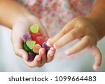 child holding candy   jelly... | Shutterstock . vector #1099664483