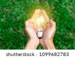 woman hand holding led bulb on... | Shutterstock . vector #1099682783
