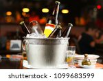 cold bottles of beer in bucket... | Shutterstock . vector #1099683599