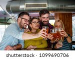 friends in local pub toasting... | Shutterstock . vector #1099690706