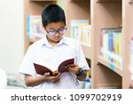 asian student is searching for... | Shutterstock . vector #1099702919