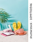 sandy beach with towel  hat and ... | Shutterstock . vector #1099703546