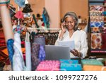 smiling mature fabric shop... | Shutterstock . vector #1099727276
