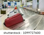 traveler waiting for luggage at Point of checking the scanner After traveling by plane . Baggage X-ray machine band on the conveyor belt at the airport counter background, Business travel concept - stock photo