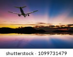 airplane flying over tropical... | Shutterstock . vector #1099731479