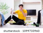 Small photo of Man with mess at home after house party