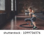 young athletic girl with a rope ... | Shutterstock . vector #1099736576