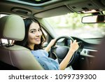 woman driver looking over the... | Shutterstock . vector #1099739300