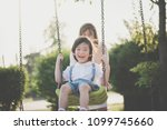 asian mother and son having fun ... | Shutterstock . vector #1099745660