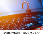 Small photo of Online shopping concept with padlock open locked with cipher on laptop beside money cards. Non secure online shopping concept.
