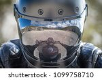 biker stay on his motorcycle... | Shutterstock . vector #1099758710