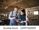 man and woman workers with... | Shutterstock . vector #1099760009