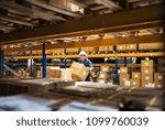 senior male warehouse worker or ... | Shutterstock . vector #1099760039