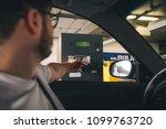 parking barrier. man taking... | Shutterstock . vector #1099763720