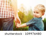father and son holding hand in... | Shutterstock . vector #109976480