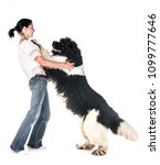 Stock photo newfoundland dog and woman in front of white background 1099777646