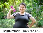 portrait of young overweight... | Shutterstock . vector #1099785173