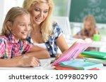 teacher with two schoolgirls | Shutterstock . vector #1099802990