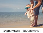 father and baby son playing on... | Shutterstock . vector #1099804049