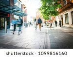 anonymous shoppers walking on a ... | Shutterstock . vector #1099816160